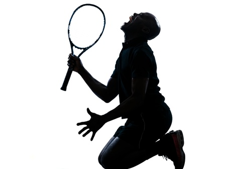 on man african afro american playing tennis player kneeling screaming on studio isolated on white background photo
