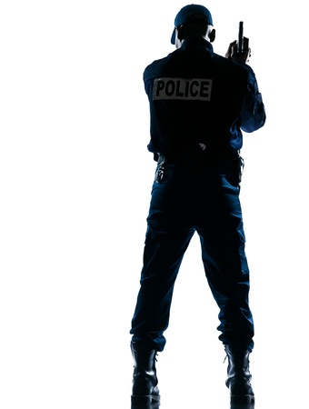 security laws: Rear view of an afro American police officer holding handgun on white isolated background
