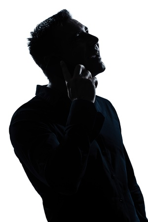 one caucasian man happy telephone portrait silhouette in studio isolated white background photo