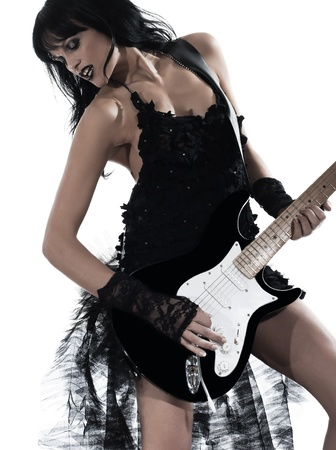 one woman playing electric guitar on studio isolated white background photo