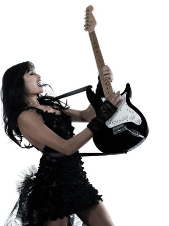 one woman playing electric guitar on studio isolated white background Zdjęcie Seryjne