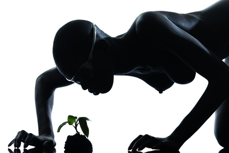 one beautiful black african naked woman protecting nature in studio isolated on white background Stock Photo - 13339324