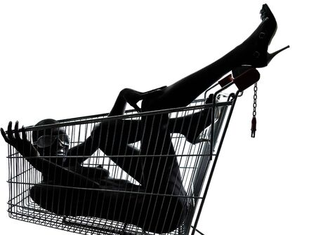 one beautiful black african naked woman sitting inside in a caddy shopping cart in studio isolated on white background Stock Photo - 13339650
