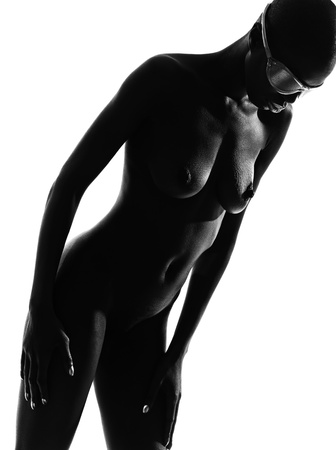 afro american nude: one beautiful black african futuristic portrait woman in studio isolated on white background Stock Photo