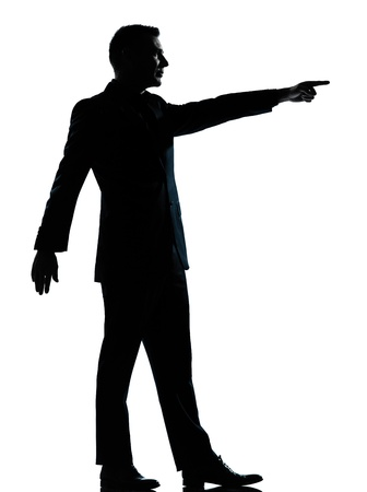 one caucasian business man silhouette standing poiting  Full length in studio isolated on white background photo