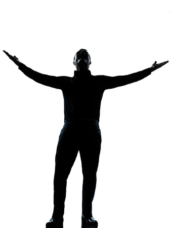 victorious: one caucasian business man happy arms outstretched silhouette Full length in studio isolated on white background