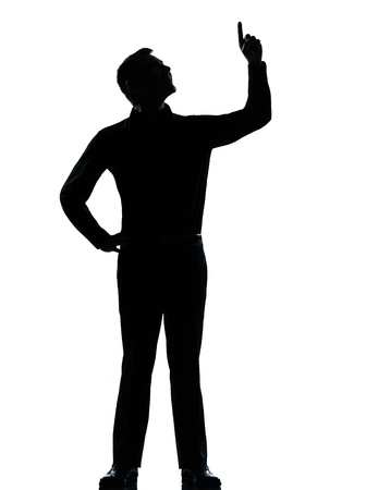 man looking out: one caucasian business man poiting up happy  silhouette standing Full length in studio isolated on white background Stock Photo