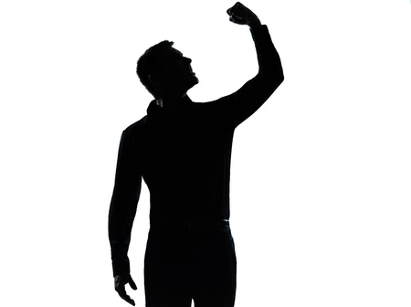 angry man: one caucasian business man angry fisting up  silhouette standing Full length in studio isolated on white background Stock Photo