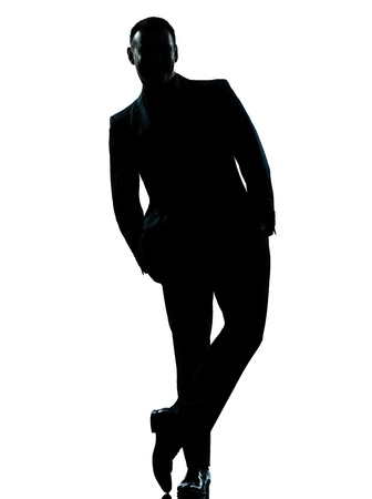 person silhouette: one caucasian business man silhouette standing Full length hands in pocket in studio isolated on white background Stock Photo