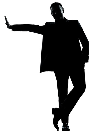 one caucasian business man silhouette standing Full length in studio isolated on white background photo