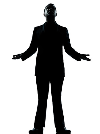 wishful: one caucasian business man hopeful looking up  silhouette standing Full length in studio isolated on white background