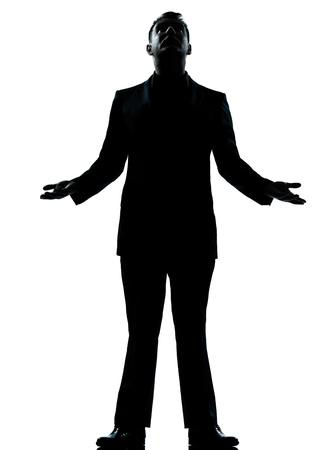 out think: un negocio cauc�sico esperanza del hombre de pie mirando la silueta de cuerpo entero en el estudio aislado sobre fondo blanco