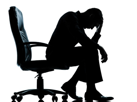 depression: one caucasian business man tired sad despair silhouette Full length in studio isolated on white background Stock Photo