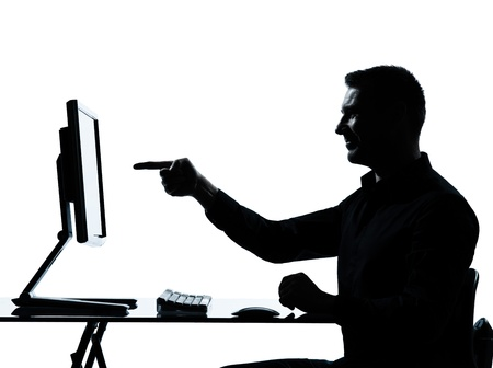 one caucasian business man pointing gesture computer computing silhouette in studio isolated on white background Stock Photo - 13339232