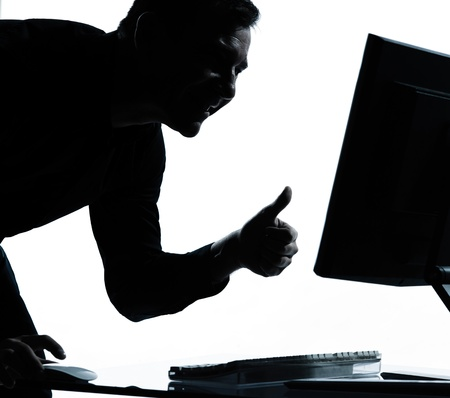 one caucasian business man computing computer thumb up satisfied portrait silhouette in studio isolated on white background photo