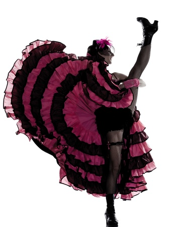 showgirl: woman dancer dancing french cancan in studio isolated on white background