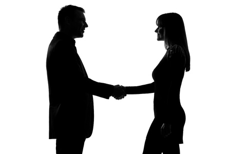 one caucasian couple man and woman handshake in studio silhouette isolated on white background Stock Photo - 13134464