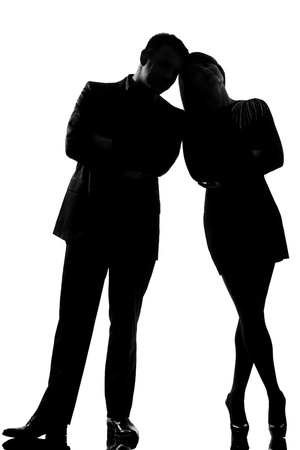 shadow face: one caucasian couple man and woman standing face to face full length in studio silhouette isolated on white background