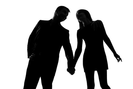 hand cut: one caucasian couple man and woman in studio silhouette isolated on white background Stock Photo