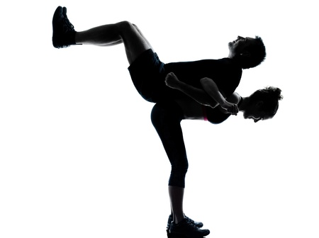 one couple man woman exercising workout aerobic fitness posture full length silhouette on studio isolated on white background Stock Photo - 13339224