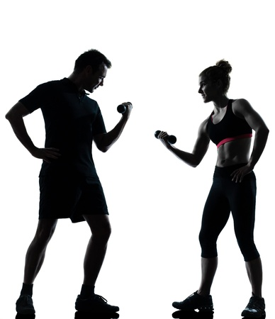 personal trainer woman: one couple man woman exercising workout aerobic fitness posture full length silhouette on studio isolated on white background