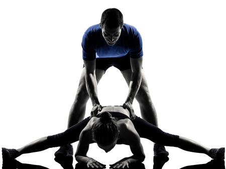 couple lit: couple woman man exercising workout fitness aerobics posture in silhouette studio isolated on white background