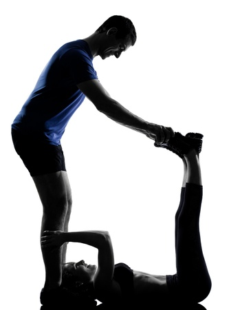 couple woman man exercising workout fitness aerobics posture in silhouette studio isolated on white background Stock Photo - 13339312