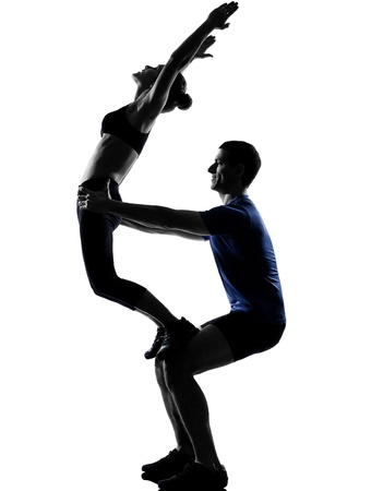couple woman man exercising workout fitness aerobics posture in silhouette studio isolated on white background Stock Photo - 13339288