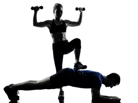 couple woman man exercising workout fitness aerobics posture in silhouette studio isolated on white background Stock Photo - 13339305