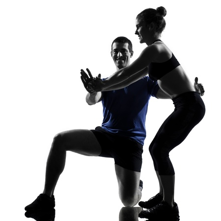 instructor: couple woman man exercising workout fitness aerobics posture in silhouette studio isolated on white background