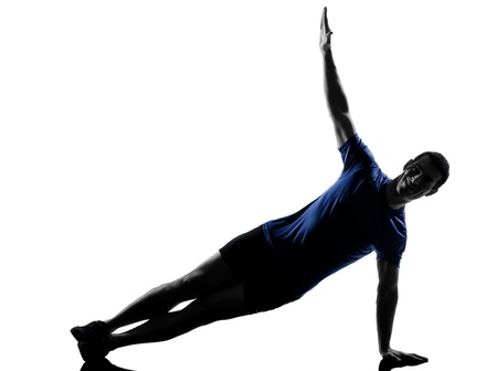 plank position: man exercising workout fitness aerobics posture in silhouette studio isolated on white background Stock Photo