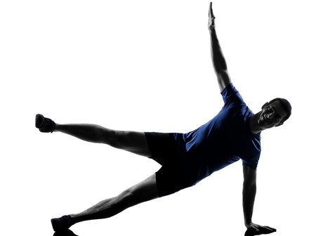 man exercising workout fitness aerobics posture in silhouette studio isolated on white background photo