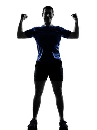 ejercicio aeróbico: el hombre el ejercicio de entrenamiento de fitness postura de ejercicios aeróbicos en el estudio de la silueta sobre fondo blanco Foto de archivo