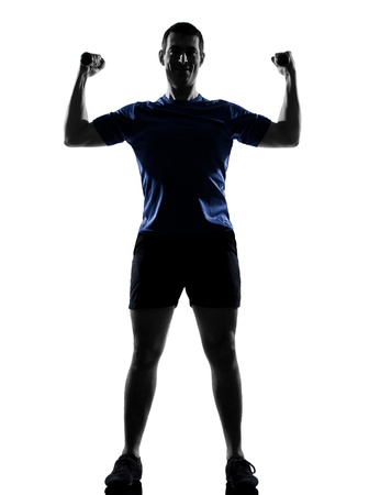 aerobic instructor: man exercising workout fitness aerobics posture in silhouette studio isolated on white background Stock Photo