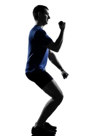 pilates man: man exercising workout fitness aerobics posture in silhouette studio isolated on white background Stock Photo
