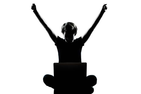 one caucasian young teenager silhouette boy  girl computer computing laptop happy success full length in studio cut out isolated on white background photo
