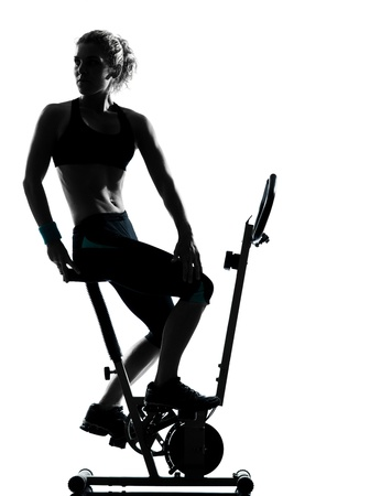 cycling silhouette: one woman biking exercising workout fitness aerobic exercise posture on studio isolated white background