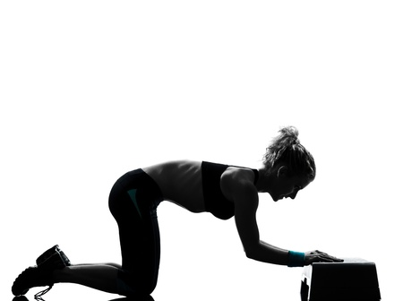 one woman exercising workout fitness aerobic exercise abdominals push ups posture on studio isolated white background Stock Photo - 13339215