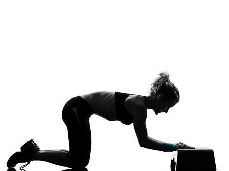 one woman exercising workout fitness aerobic exercise abdominals push ups posture on studio isolated white background Stock Photo - 13339215