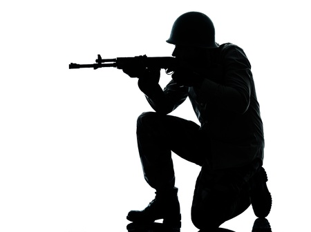 soldier silhouette: one caucasian army soldier man shooting on studio isolated on white background