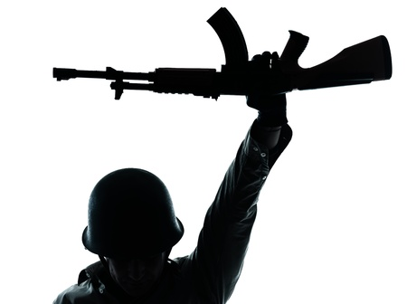 man with gun: one caucasian revolutionary army soldier man holding ak47 kalachnikov on studio isolated on white background Stock Photo