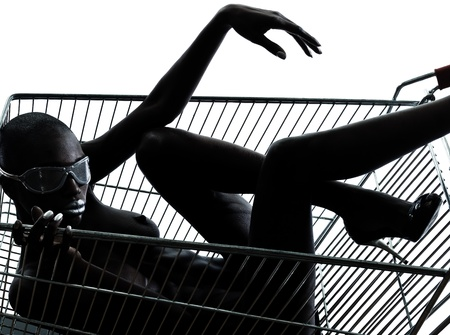 african american nude: one beautiful black african naked woman sitting inside in a caddy shopping cart in studio isolated on white background