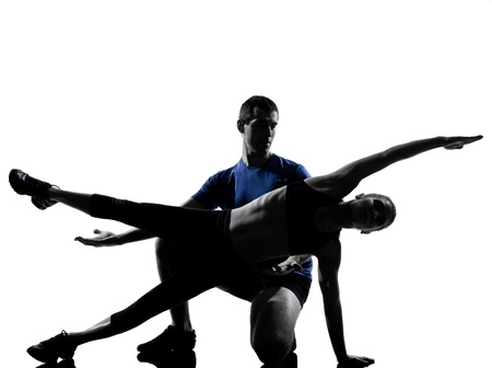 couple woman man exercising workout fitness aerobics posture in silhouette studio isolated on white background Stock Photo - 13525358