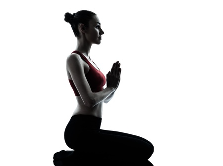 side pose: one caucasian woman exercising yoga meditating in silhouette studio isolated on white background Stock Photo