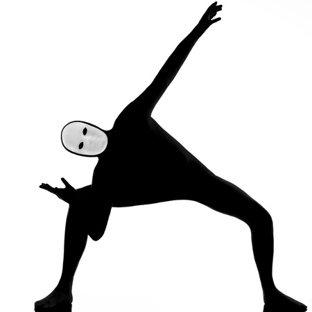 performer man mime with mask stretching flexibility on studio isolated on white background photo