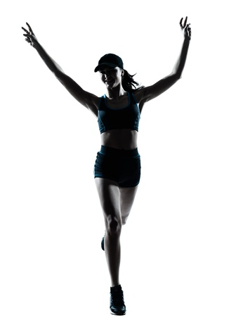 winning woman: one caucasian woman runner jogger victorious in silhouette studio isolated on white background