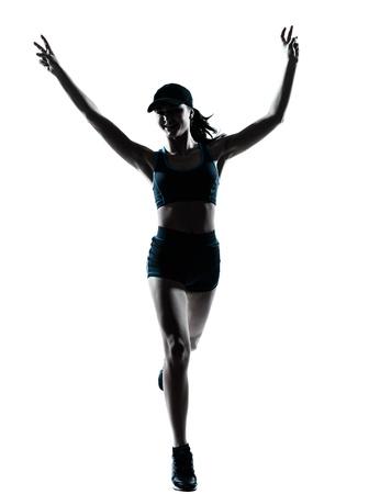 victoire: une joggeuse caucasien coureur femme victorieuse en studio silhouette isol� sur fond blanc