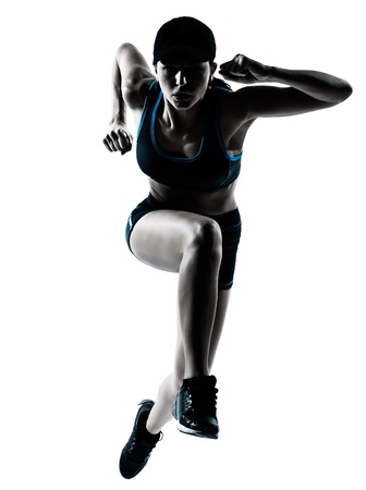one caucasian woman runner jogger jumping in silhouette studio isolated on white background photo