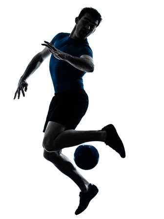 action shot: one caucasian man playing soccer football player silhouette  in studio isolated on white background Stock Photo
