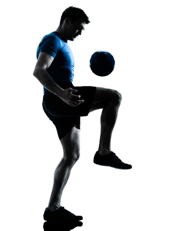 one caucasian man playing soccer football player silhouette  in studio isolated on white background Imagens
